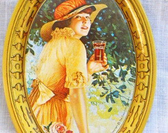 Vintage 1973 Coca Cola Souvenir Metal Art Deco Mini Tray Pin Tray with 1917 Girl in Hat Yellow Dress and Roses