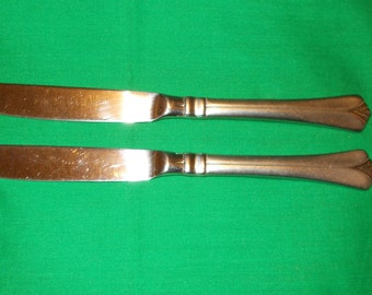 """Two (2), Solid Handle, 9"""" Dinner Knives, from Pfaltzgraff Silver, in the Satin Ellington Pattern."""