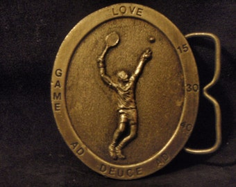 Pewter tennis buckle.