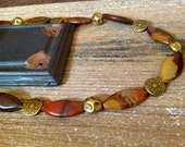 Handmade necklace and earring set, autumn horse eye with brass metal