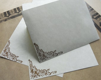 Parchment paper stationery set. Writing paper hand stamped with baroque motif border, set of 30.