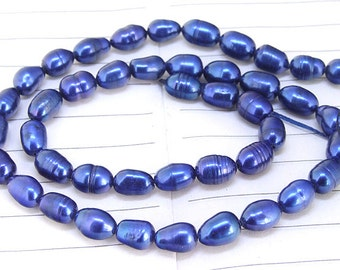 One Full Strand--- Luster Rice Blue Pure Freshwater Pearl----6mm-7mm----about  41 Pieces----15.5 inch strand