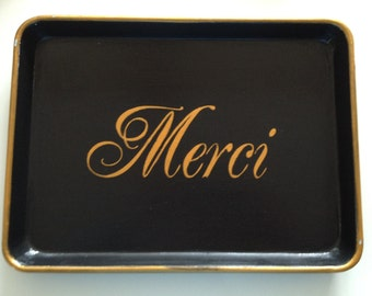 M gold Merci black tray