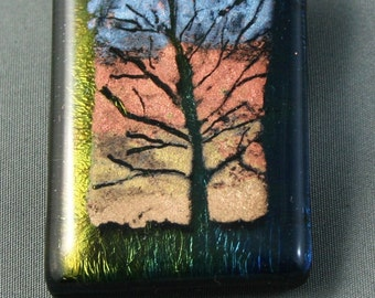 Fused glass pendant with screen printed  tree made of  mica in metallic colours