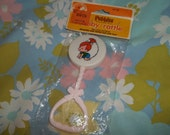 Vintage 1979 Pebble Flintstone baby rattle - still in package