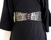Black and silver elasticated cinch belt with gunmetal clasp