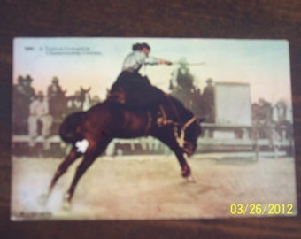 """Vintage 1890 -1920's  """"A Typical Cowgirl in Championship Contest"""" Postcard"""