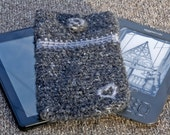 Crocheted kindle / kindle fire cover in charcoal grey and pale grey yarn with crocheted button fastener