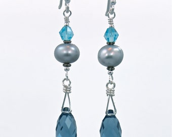 Beautiful sterling earring with denim blue Swarovski crystals.
