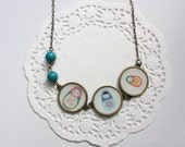 3 handmade necklaces, 6 brooches and 3 bracelets with matryoshka  print