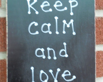 Keep calm and love dogs sign
