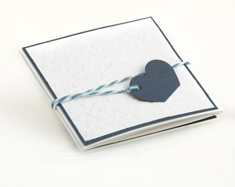Handmade custom romantic folded wedding invitation, embossed background and blue navy  heart.