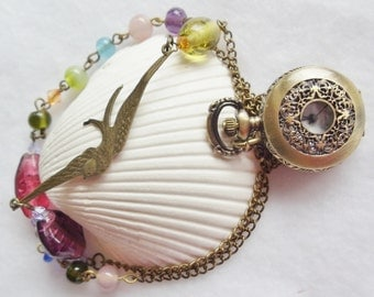 Swallow pocket watch with colorful glass beads and swallow on bronze chain