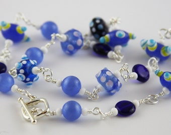 Wire wrapped navy, blue and white lampwork bead necklace