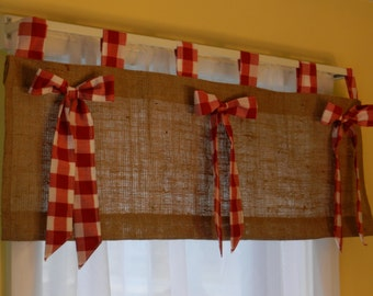 burlap tab valance with red and white check tabs and bows.