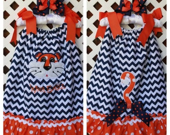 Auburn pillowcase dress with two appliques, monogramming and a matching hairbow.