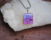 She is too fond of books and it has turned her brain -  Scrabble Tile Resin Necklace