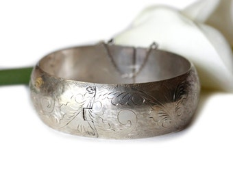 Vintage sterling silver clamper wide bangle bracelet with floral etching, safety chain