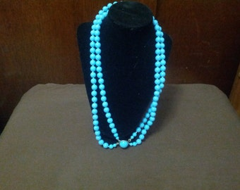 Vintage Blue plastic beaded necklace with gold tone clasp