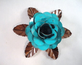 Large Metal Hand Cut and Hand Painted Rustic Turquoise Rose Mounted on a Bed of Metal Leaves.