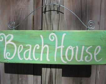 BEACH HOUSE sign hand painted on reclaimed dock wood