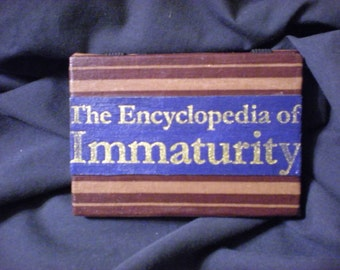 """Book Cover Magic Wallet: """"The Encyclopedia of Immaturity"""""""