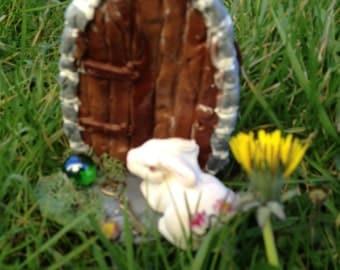 Roggie the Rabbit went through a fairy door garden miniature doll house ooak  art doll sculpture polymer clay artist sculpt