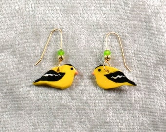 Handpainted ceramic goldfinch earrings w 12K goldfilled earwires and glass beads.