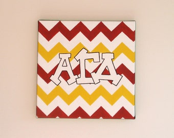 hand painted alpha gamma delta letters outline with chevron background 12x12 canvas official licensed product