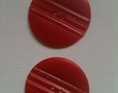 Two Large Red Bakelite Buttons