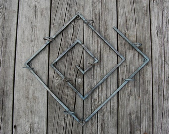 Metal 'Hard Spiral' Candle Wall Decor