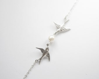 Silver Bracelet with two birds and white pearl