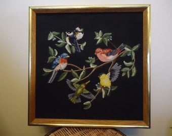Framed Crewel wallhanging of birds of various species on branches