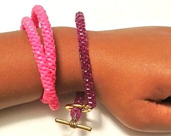 Woven Plastic Bracelet, Color Families- Oranges, Pinks/Reds, and Neutrals