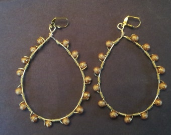 Tear drop hoop earrings.