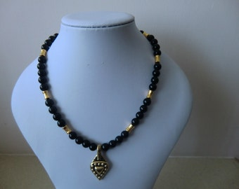 Necklace, black, glass beads with gold parts