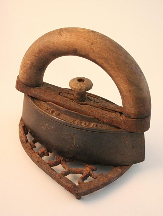 Antique Cast Iron Handles : Antique cast iron mrs potts sad with wood handle and