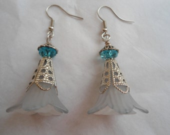 Snow princess earrings:  Large snowy light blue trumpet lily flower lucite earrings