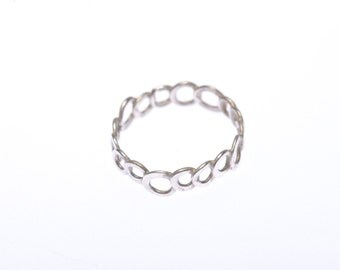Open form delicate silver ring