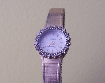 Armitron goldplated watch with diamond accents around face