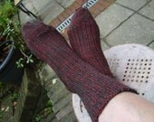 knitting socks step by step on a circular needle.