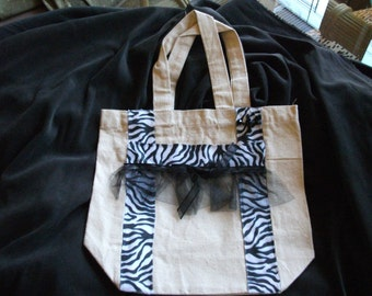 Natural color tote trimmed in black & white ribbon