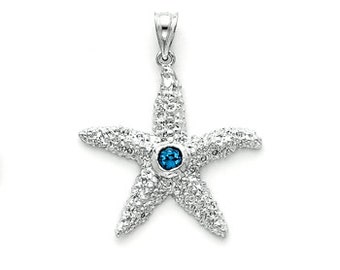 Sterling Silver Star Fish textured  charm w/ Blue Topaz center stone.