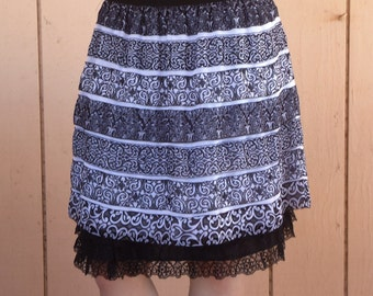 Black slip extender with three tiered layered lace.
