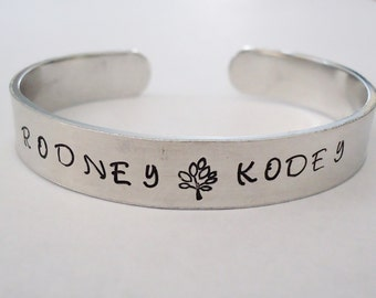 Name Personalized Bracelet cuff- You choose the words and or the designs stamped on it - made just for you - custom bracelet