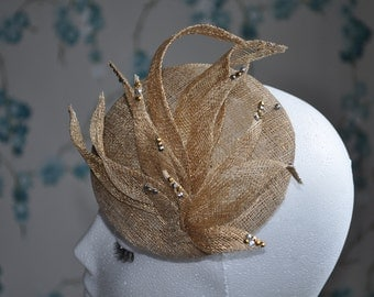 Gold Fascinator made from sinamay with rhinestones on tips of petals for subtle sparkly effect