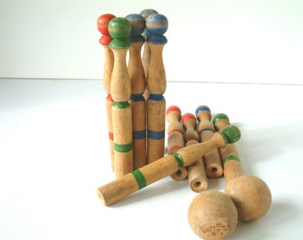 Set of 10 French vintage painted wooden bowling skittles with wooden ball.