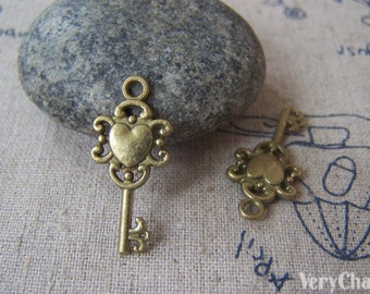 10 pcs of Antique Bronze Filigree Key Charms 12x26mm A3585