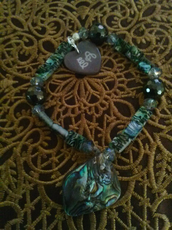 """Ema Arius Collection with Sorcha's Adornments 7 1/2"""" stretchy bracelet with 4 grey diamond beads, Abalone shell charm"""