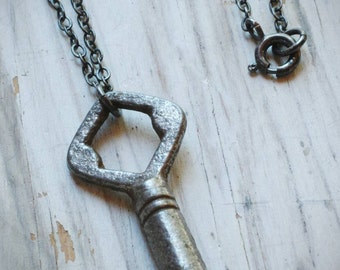 simple little secret necklace. small, vintage, diamond-shaped cabinet key on oxidized sterling silver by val b.